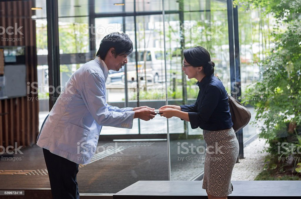 Japanese business man and woman exchange businesscard at kyoto japan japanese business man and woman exchange businesscard at kyoto japan royalty free stock photo colourmoves