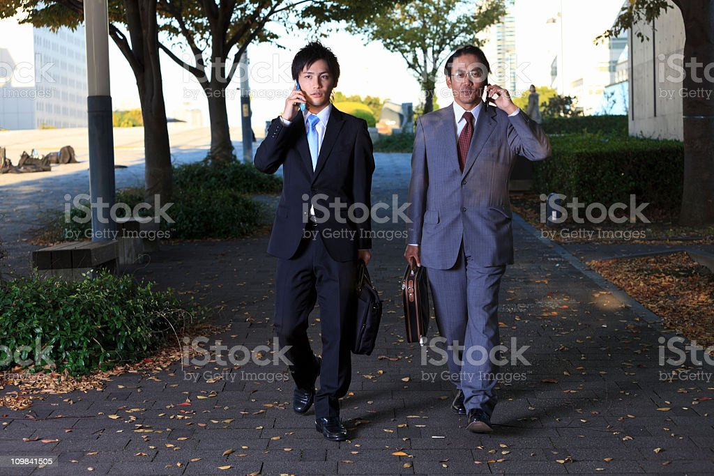 Japanese business men - talking on the phone stock photo