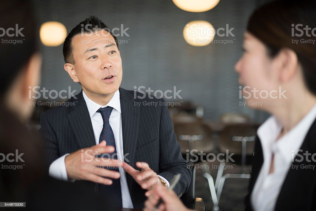 Japanese business people having discussion in meeting stock photo