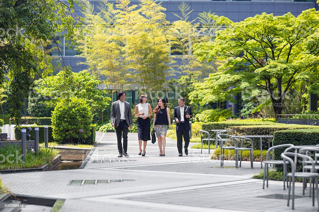 Japanese business people walking to the office stock photo