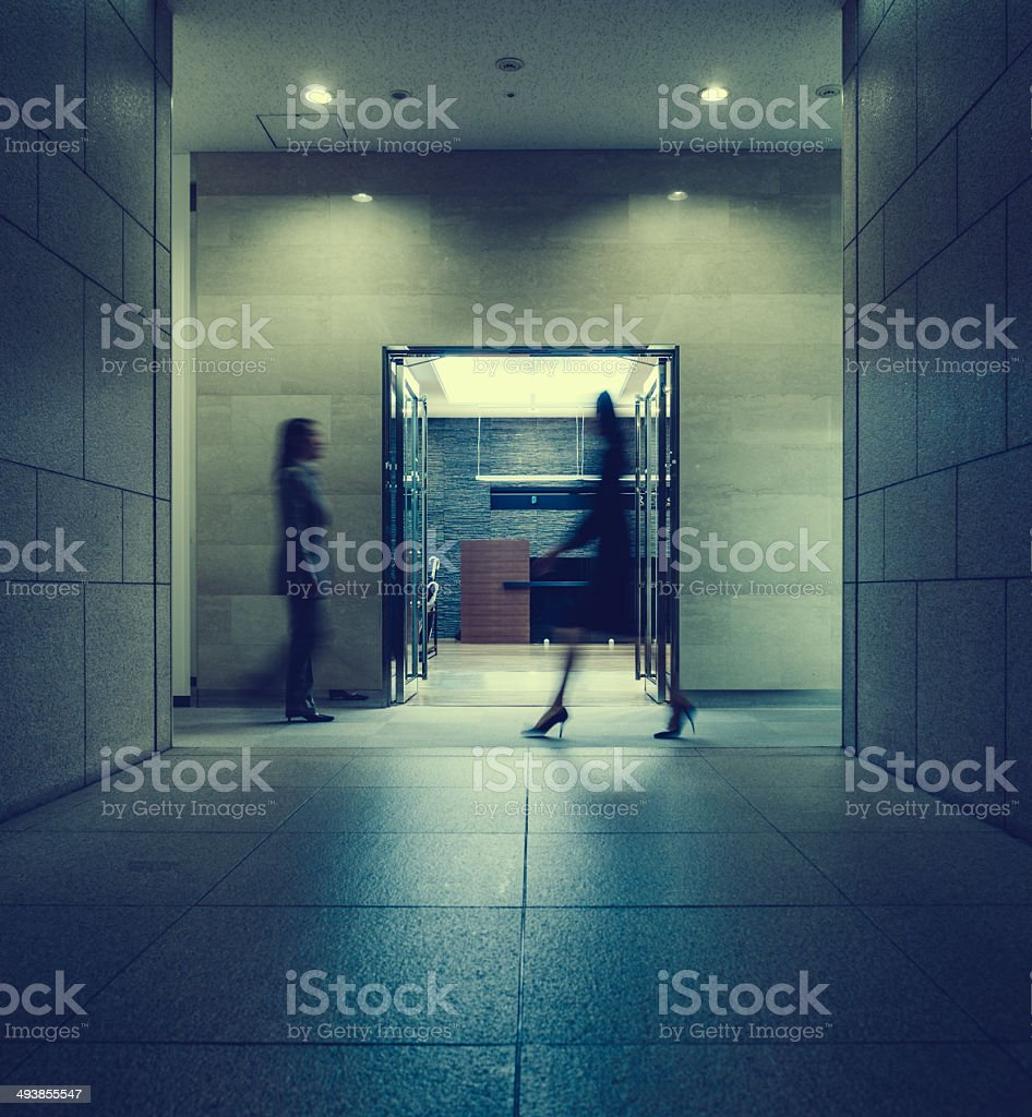japanese business women walking inside a corporate building stock photo