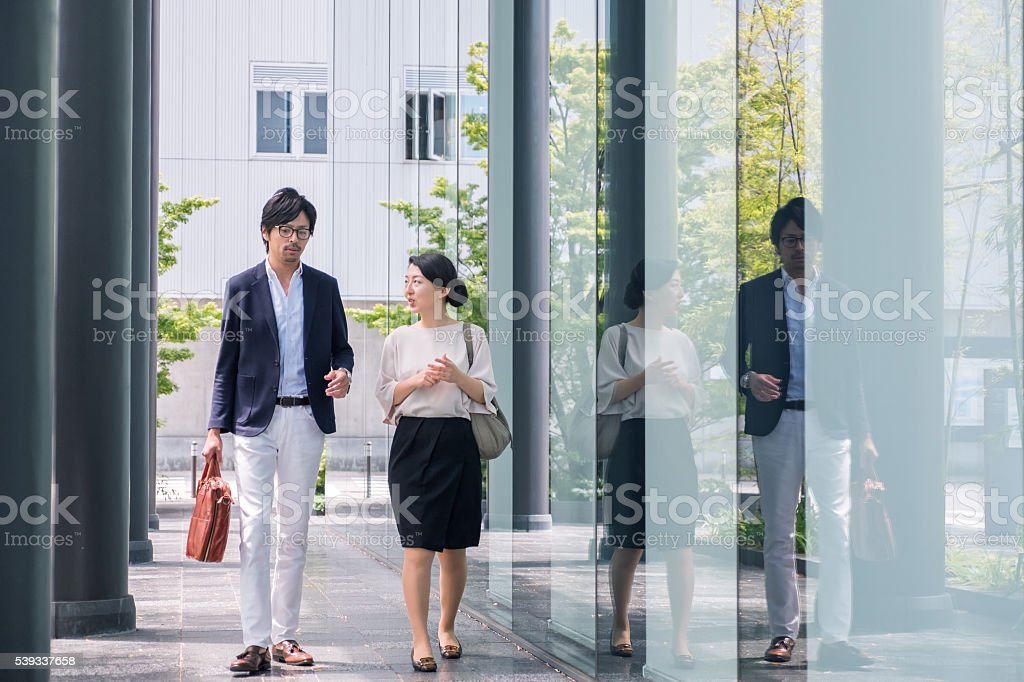 Kyoto iStockalypse. Young Japanese business colleagues at a business...