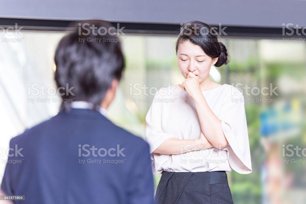 Japanese Businessman are listening woman's talking stock photo