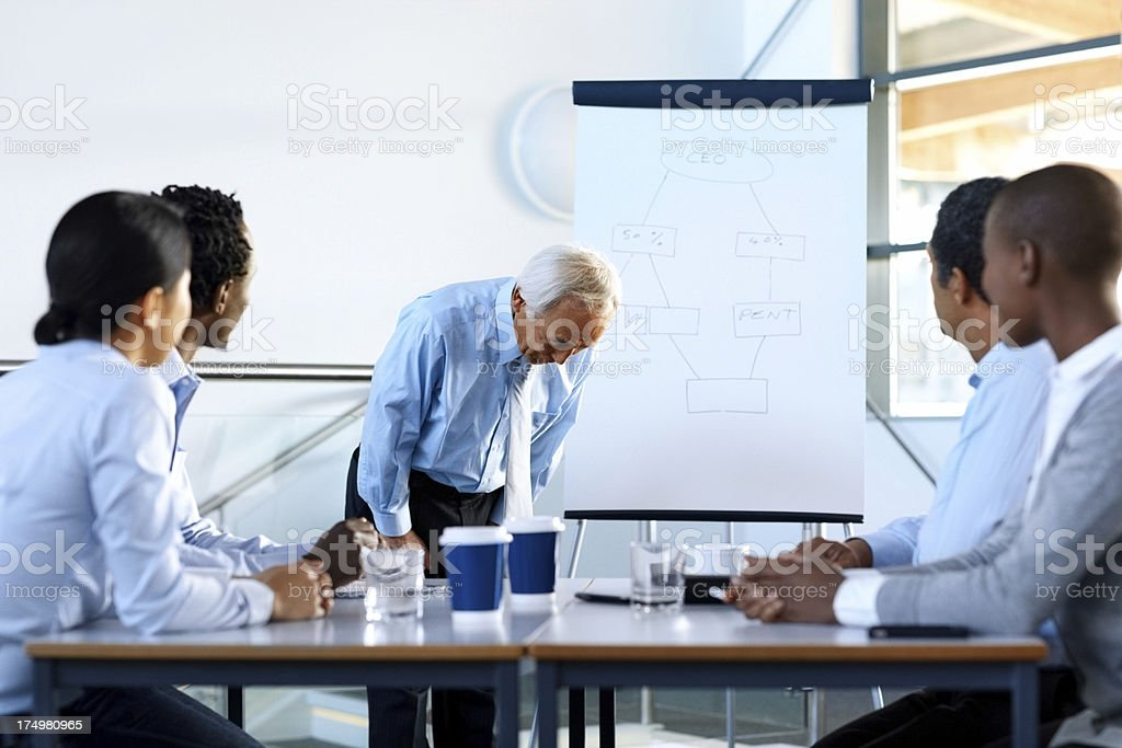 Japanese businessman bowing in presentation royalty-free stock photo