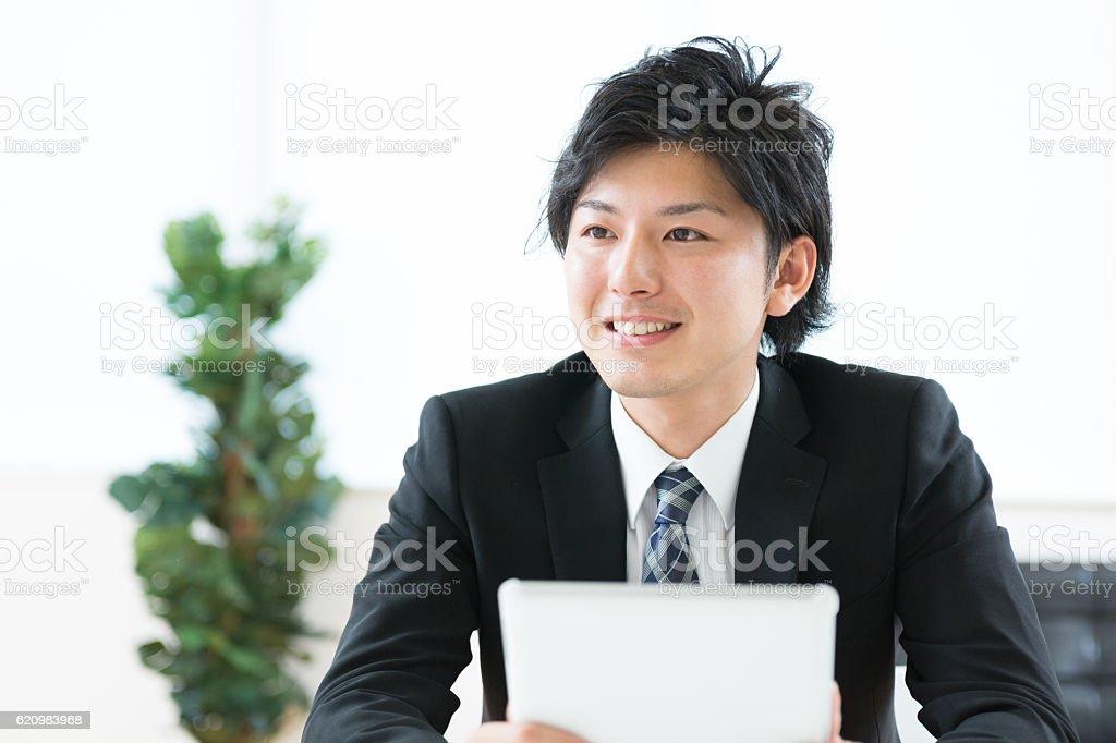 Japanese businessman holding a digital tablet ストックフォト