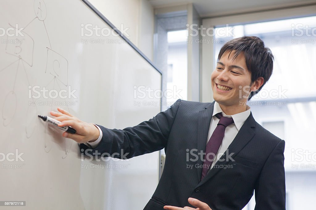 Japanese businessman holding a meeting stock photo