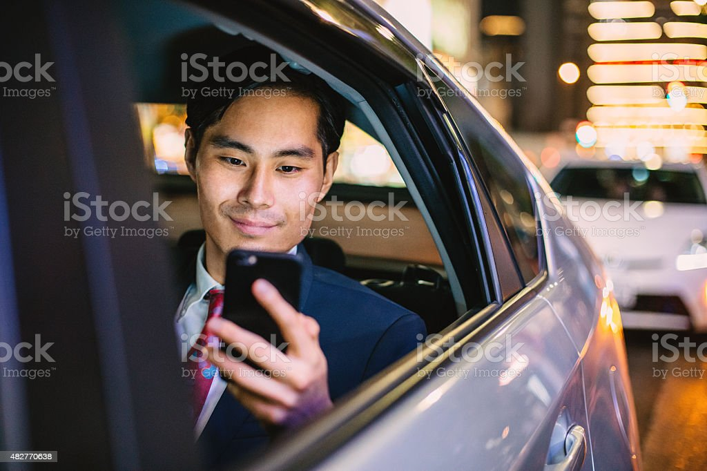 Japanese businessman in a car at the night stock photo