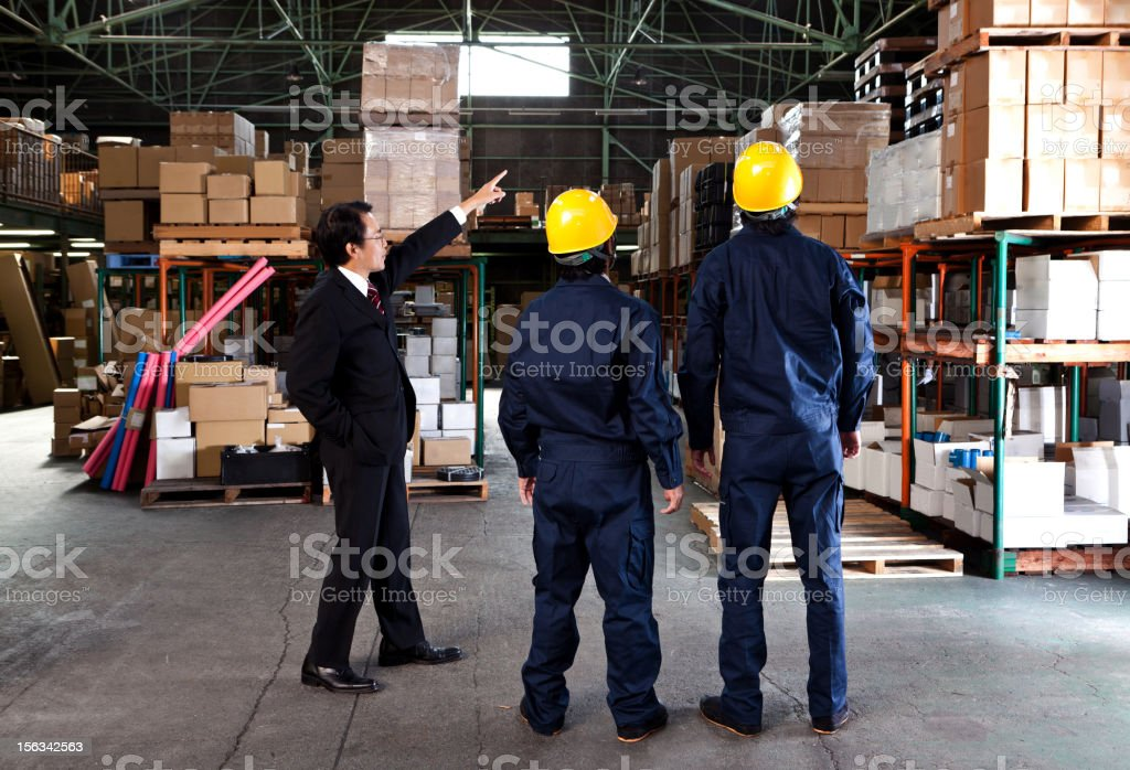 Japanese Businessman in a warehouse royalty-free stock photo