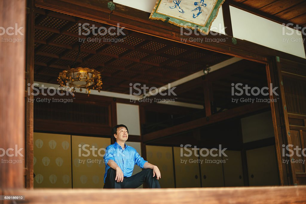 Japanese businessman in Chijon-ji Shrine meditating after hard working day stock photo
