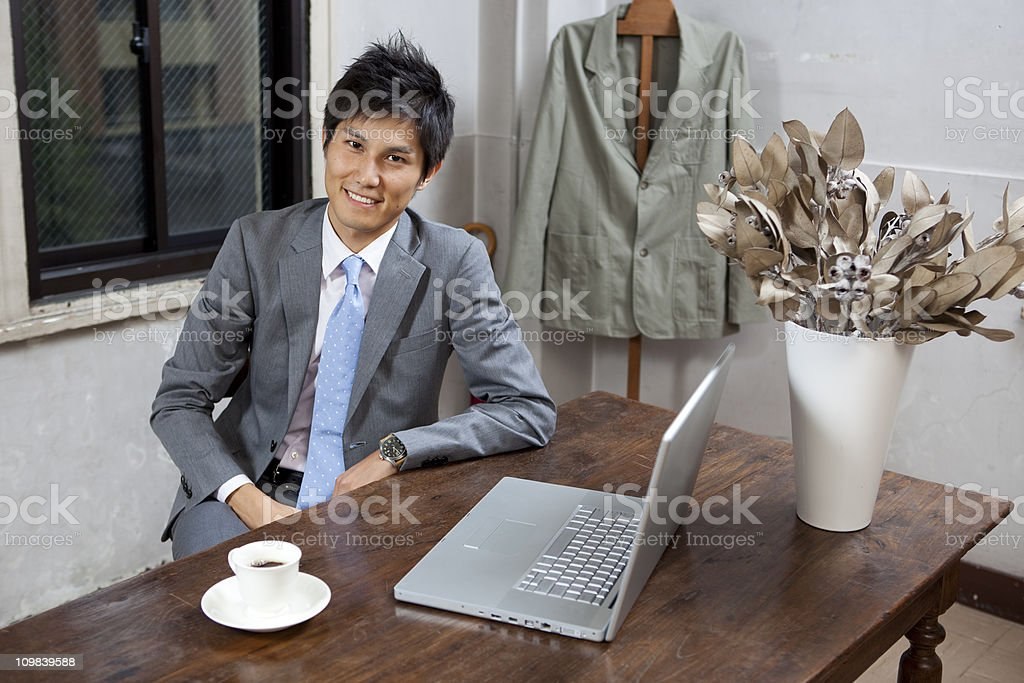 Japanese Businessman smiling in office royalty-free stock photo