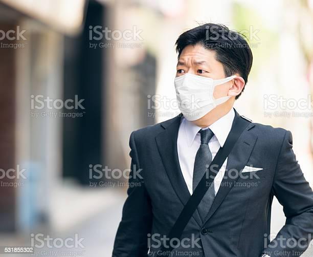 Japanese businessman wearing a facemask on tokyo street picture id531855302?b=1&k=6&m=531855302&s=612x612&h=6uelyk4wmjzwyz5byinkybx0bsfpeh1emqpktcctbv0=