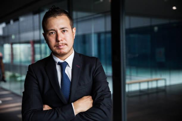 オフィスで日本のビジネスマン - オフィスワーク ストックフォトと画像