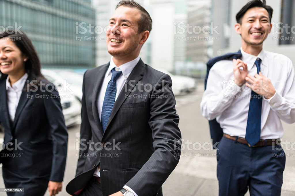 japanese Businessmen on the street of Osaka stock photo