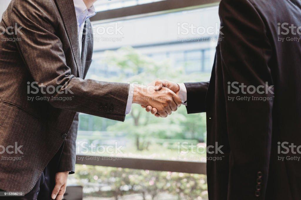 Japanese businessmen shaking hands stock photo