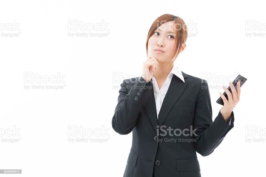 Japanese businesswoman holding a smart phone foto royalty-free