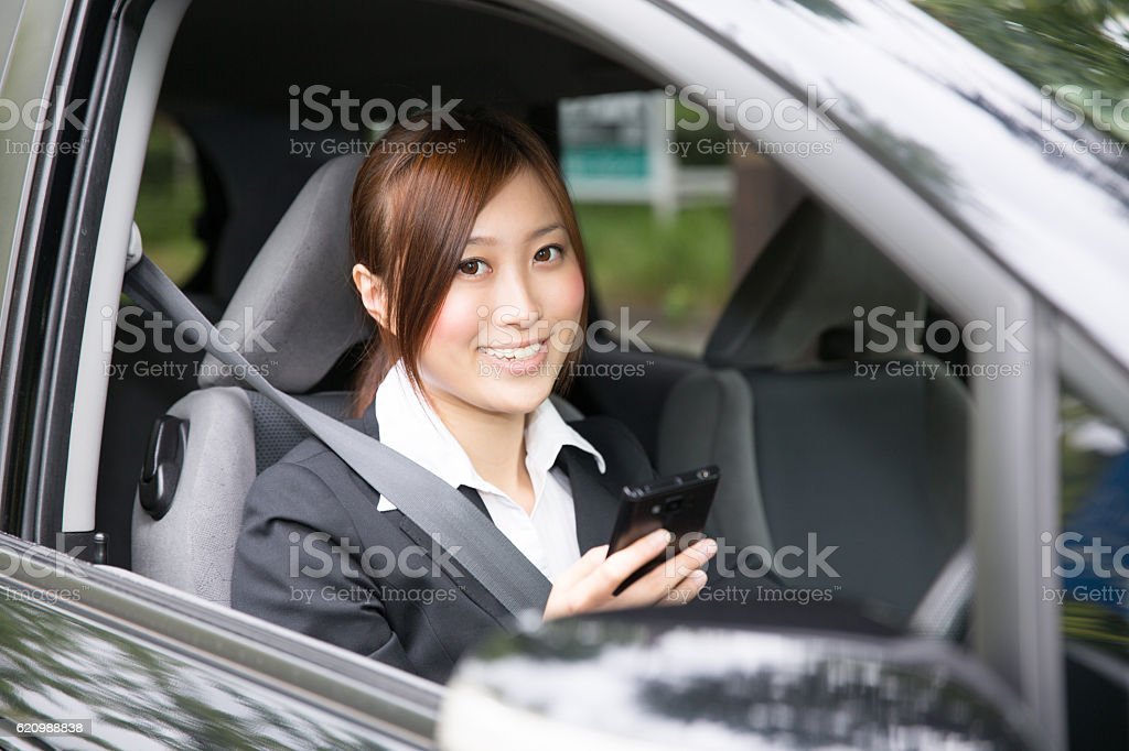 Japanese businesswoman sitting in the car foto royalty-free