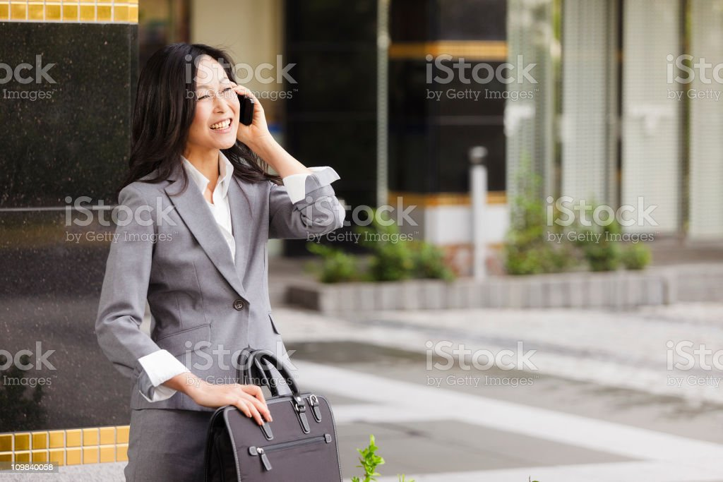 Japanese Businesswoman Talking on Telephone stock photo