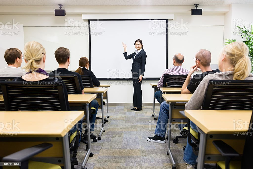 A Japanese businesswoman teaching seminar to class stock photo