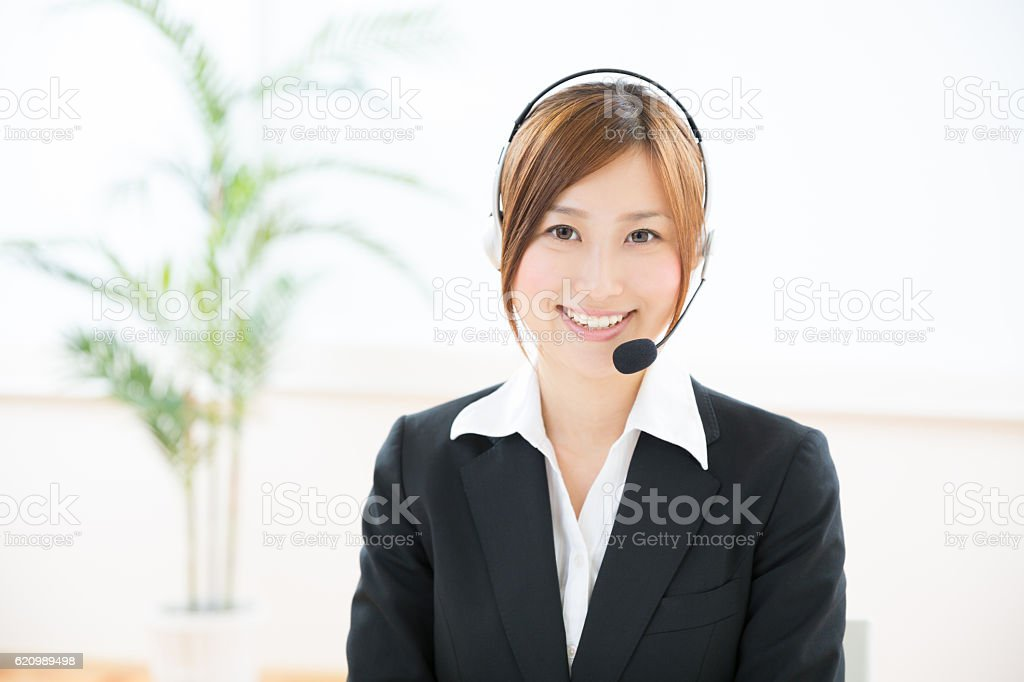 Japanese businesswoman wearing headset foto royalty-free