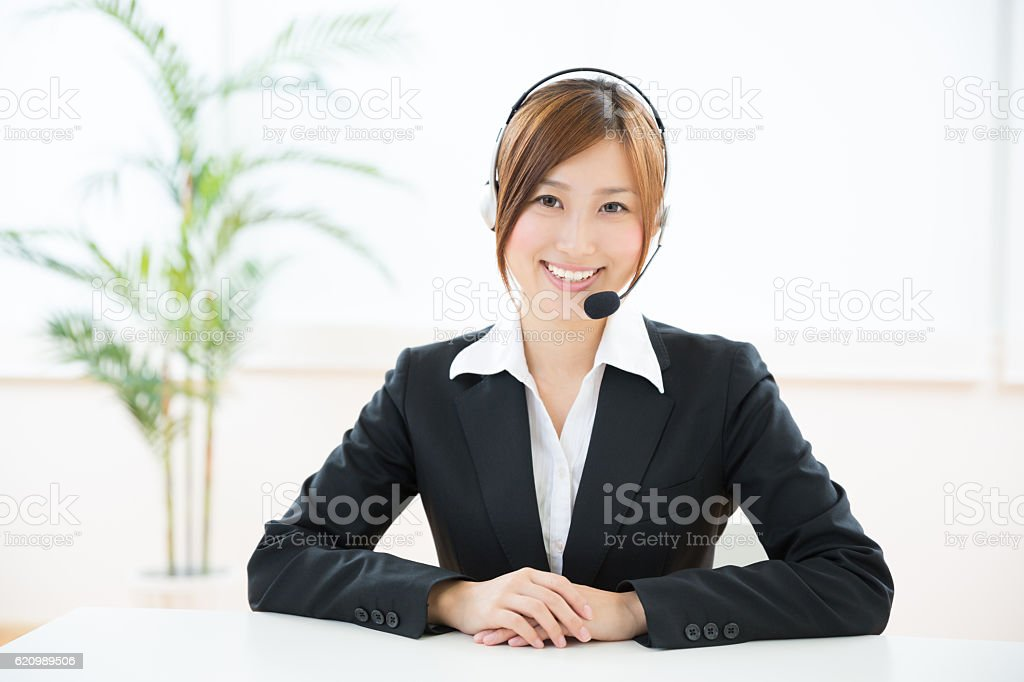 Japanese businesswoman wearing headset foto royalty-free