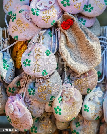Osaka, Japan - October 24 2014: Japanese charms commonly sold at religious sites Shinto and Buddhist, provide various forms of luck or protection.