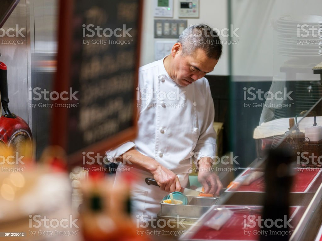 Japanese Chef Working in a Tokyo Restaurant stock photo