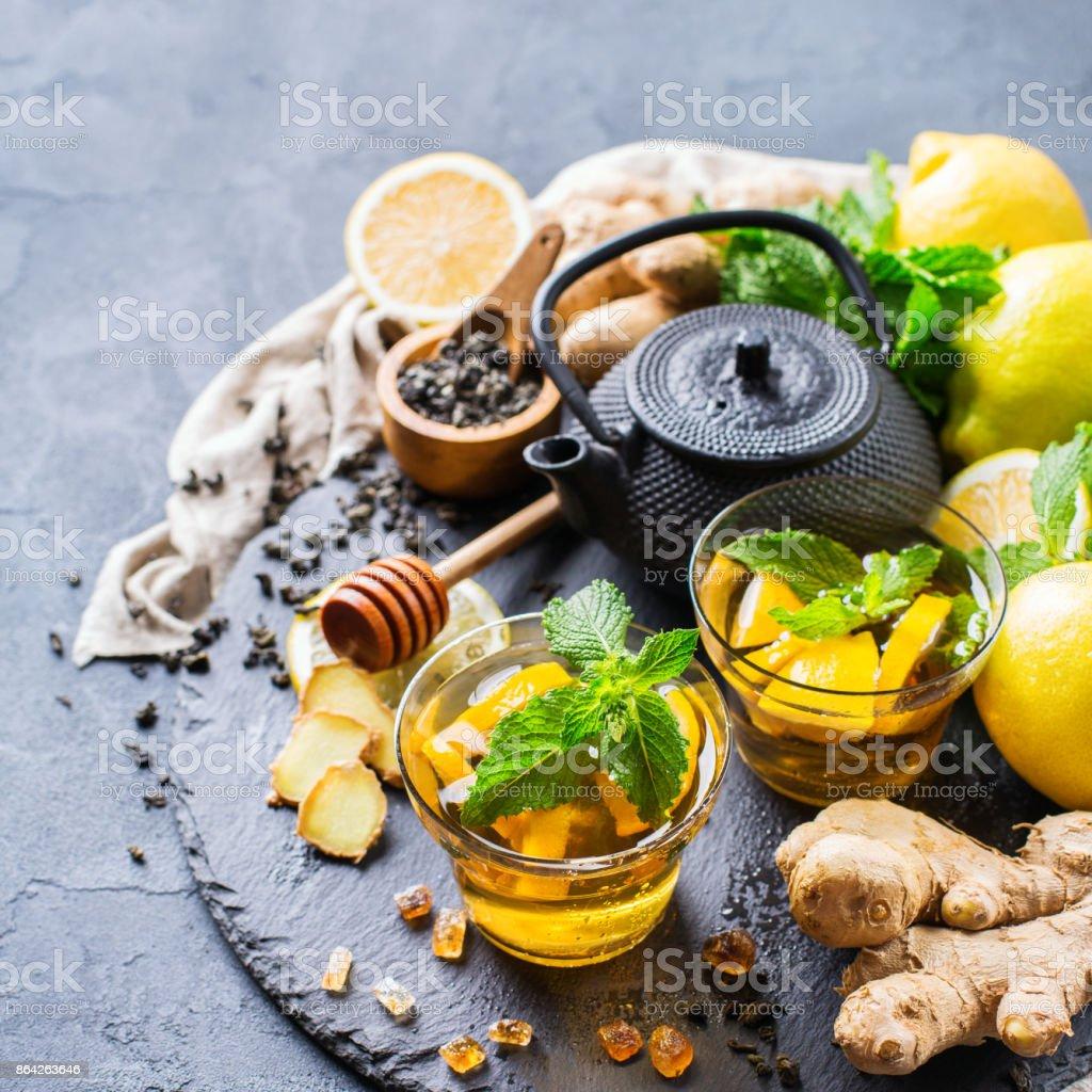 Japanese chinese tea teapot lemon ginger mint honey royalty-free stock photo