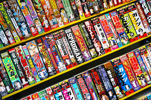 japanese comics on sale outdoor in tokyo - manga style stock photos and pictures