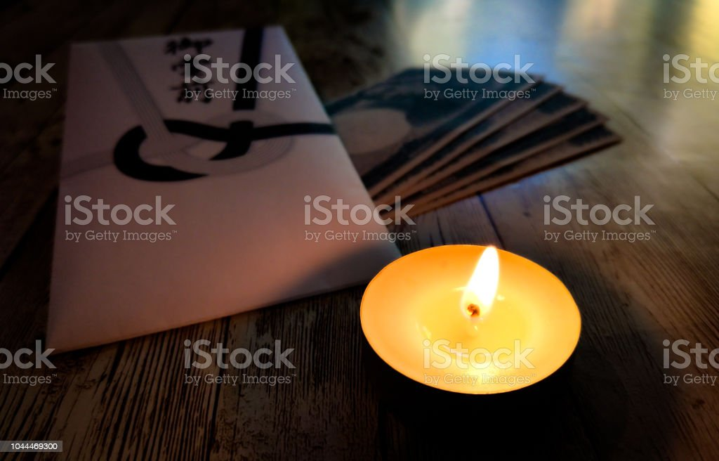 Japanese Condolence funeral envelope and candle stock photo
