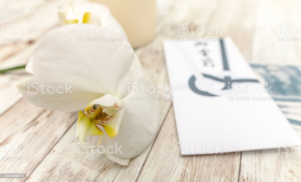 Japanese Condolence Funeral Envelope with money and an orchid flower stock photo
