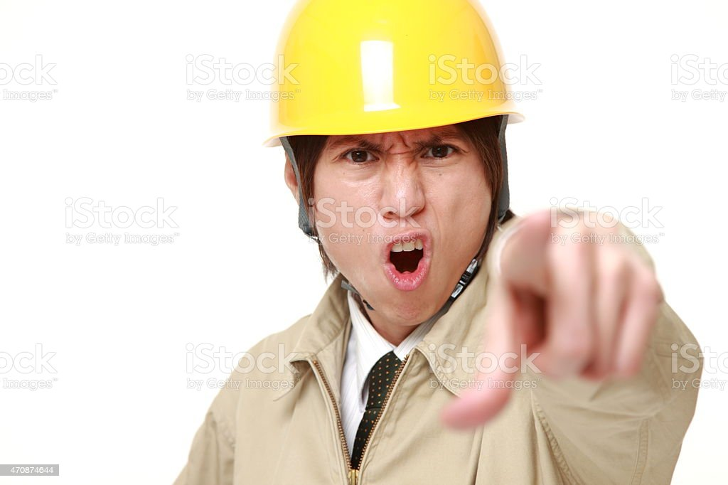 Japanese construction worker scolding stock photo