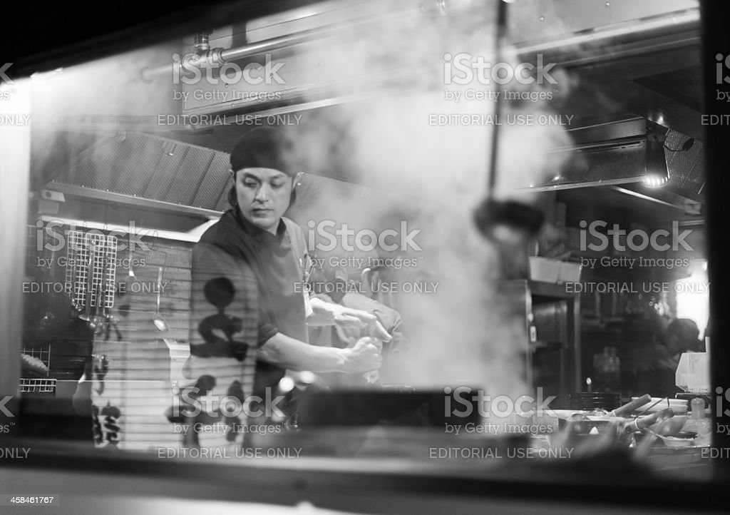 Japanese cook in the kitchen of a ramen restaurant, Kyoto stock photo