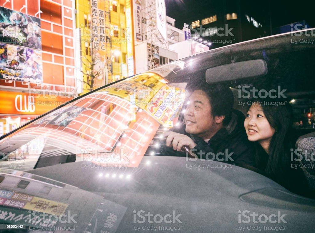 Japanese Couple Driving in Akihabara Tokyo stock photo