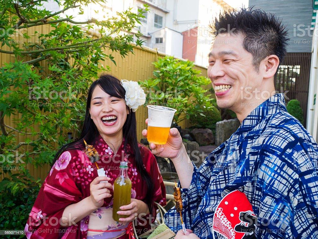 Japanese couple enjoy eating  at the Festival. stock photo