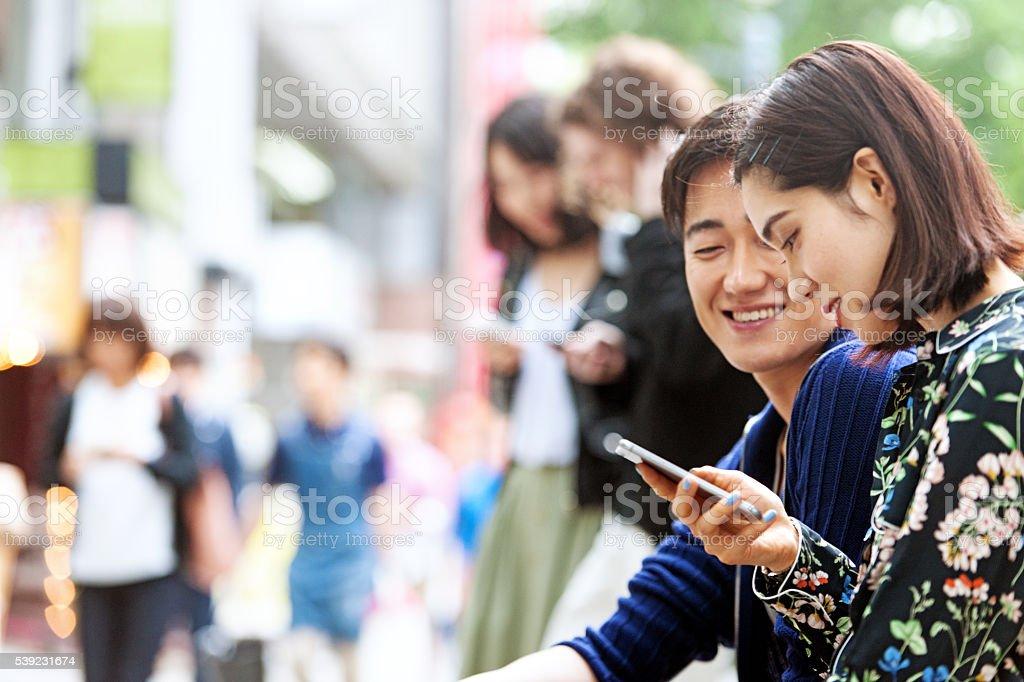 Japanese couple in Shibuya royalty-free stock photo