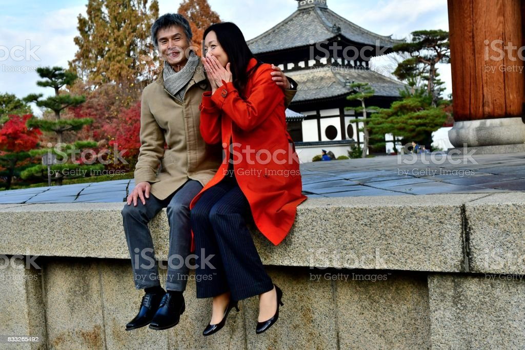 Japanese Couple in their 40's Relaxing at Tofuku-ji Temple, Kyoto stock photo
