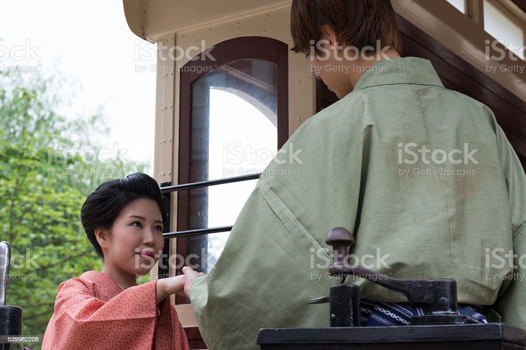 Japanese couple in Yukata on a train stock photo