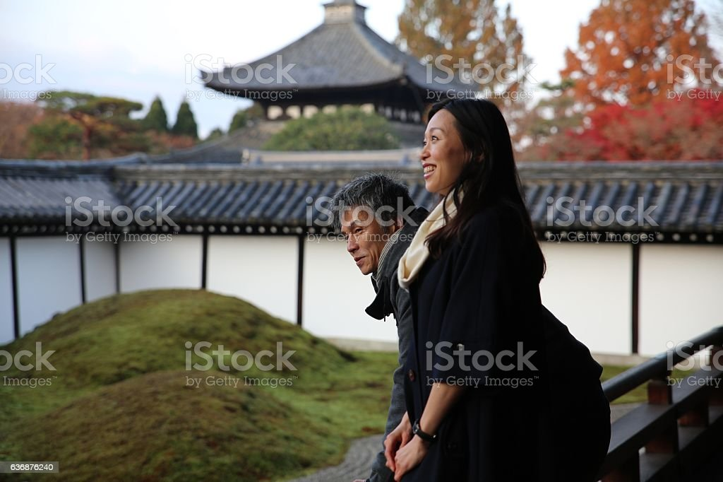 Japanese couple looking japanese gaeden of Tofuku temple stock photo