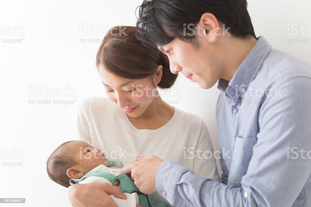Japanese couple playing with baby stock photo