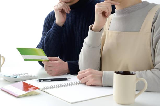 Japanese couple thinking about housekeeping budget stock photo
