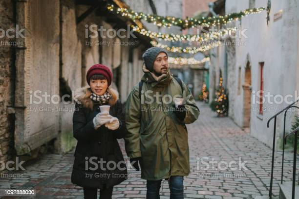 Japanese couple walking in european city during christmas picture id1092888030?b=1&k=6&m=1092888030&s=612x612&h=as8biflyesedxdpfecyhzrhxbgco3obzvsujxfr22qu=