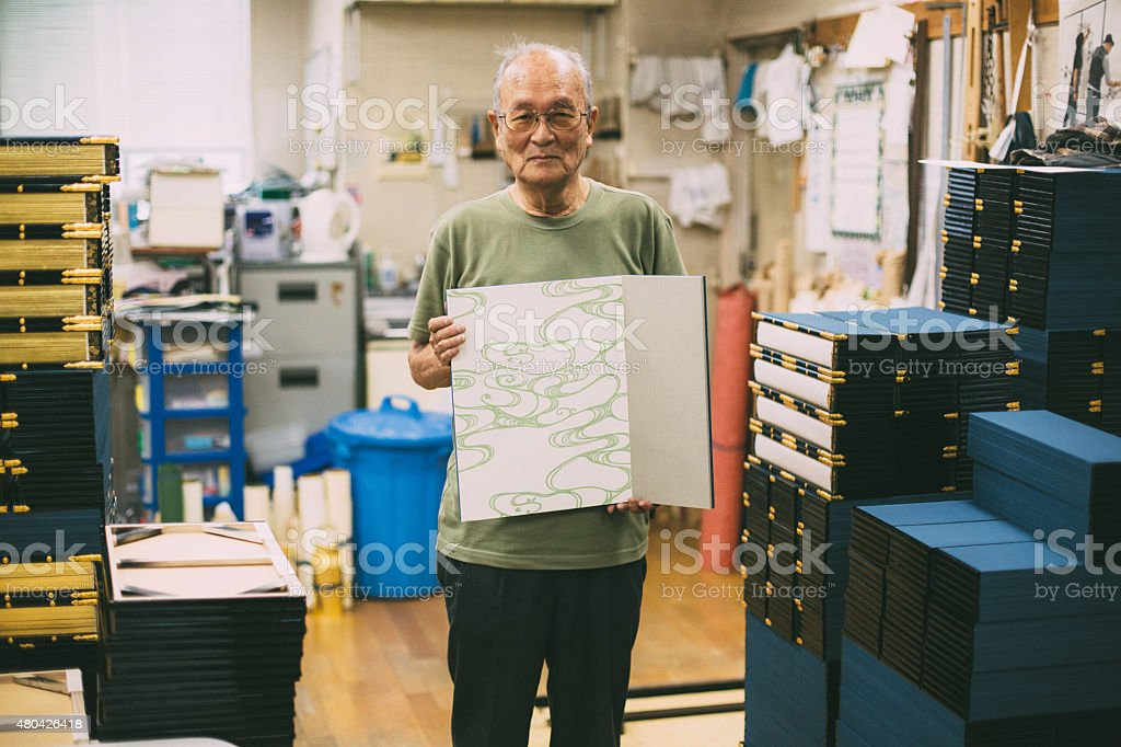 Japanese craftsman is showing his craft work. He is staying in the...