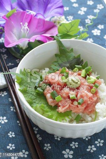 Japanese cuisine, chopped tuna belly sashimi with scallion over sushi rice.