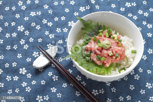Japanese cuisine, chopped tuna belly sashimi with scallion over sushi rice.