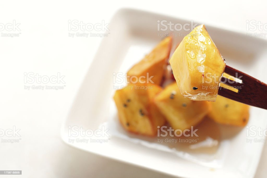japanese cuisine, Daigakuimo Candied sweet potato with sesame royalty-free stock photo
