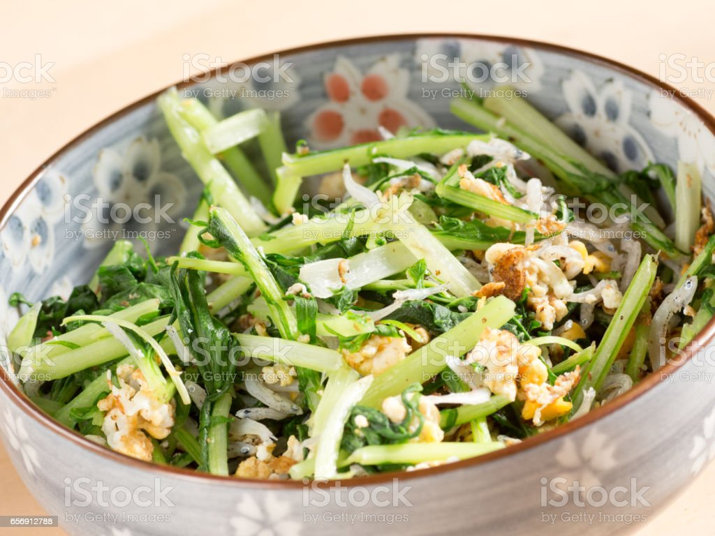 Japanese cuisine, fried potherb mustard leaf and egg stock photo