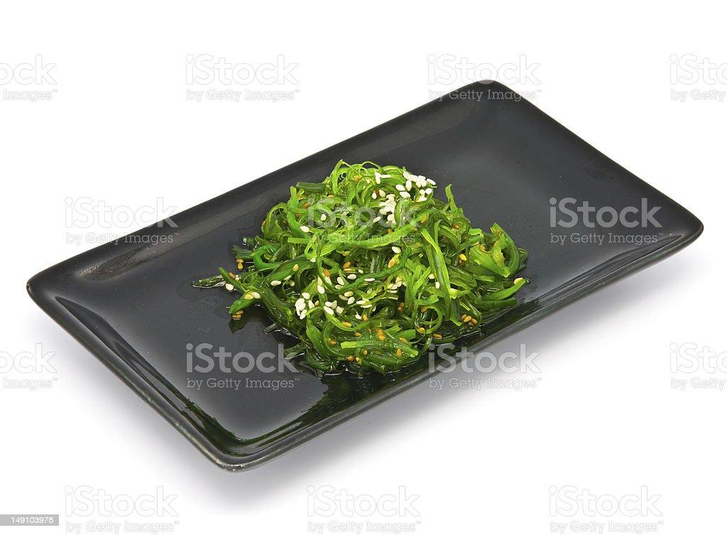 Japanese Cuisine , Seaweed Salad in black plate royalty-free stock photo