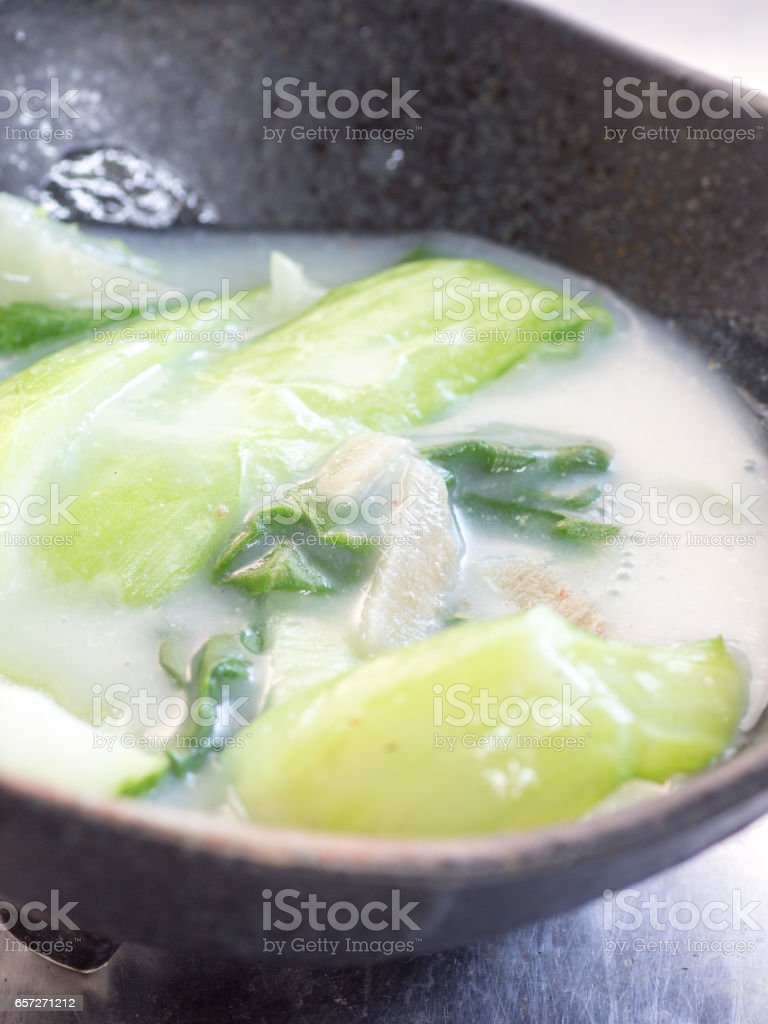 Japanese cuisine, simmered bok-choy in the milk soup stock photo