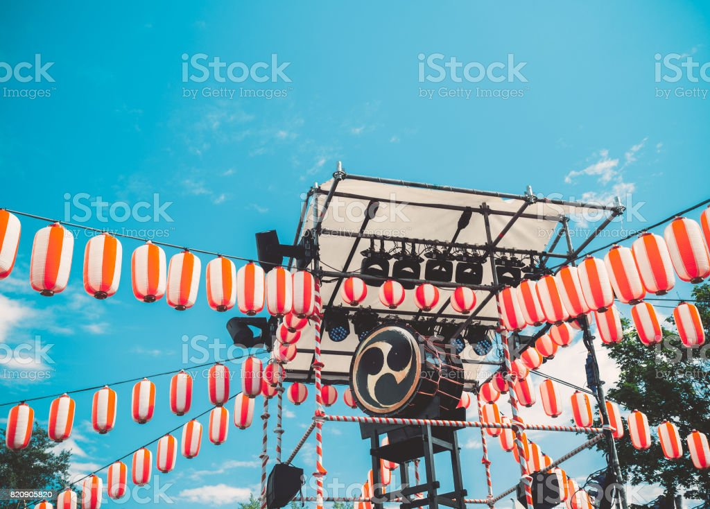 Japanese drum Taiko on the stage of the Yaguro. Paper red-white lanterns Chochin Scenery for the holiday Obon stock photo