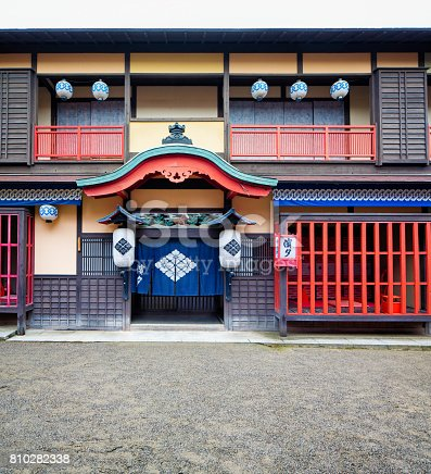 Japanese Edo village inn exterior movie set at Toei Studios Kyoto on an overcast day.